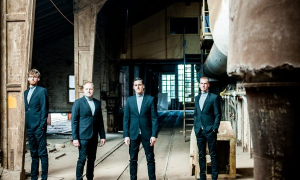 THE JENGLERS wearing suits in old factory on first promotion picture done by John Alexander Bell in October 2019