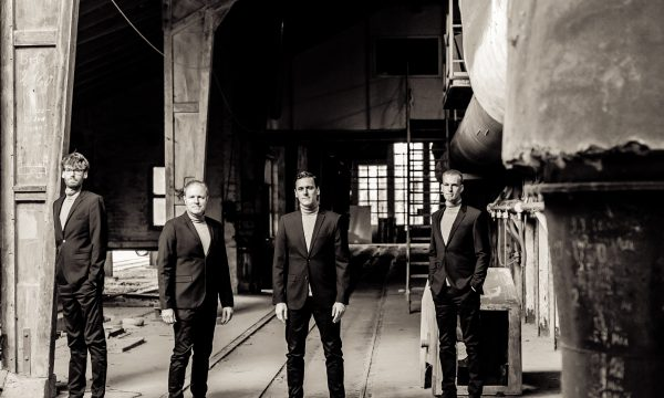 THE JENGLERS wearing suits in old factory on first promotion picture in sepia done by John Alexander Bell in October 2019