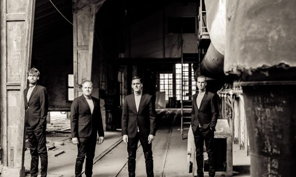 THE JENGLERS wearing suits in old factory on first promotion picture in sepia done by John Alexander Bell in October 2019 optimized for web
