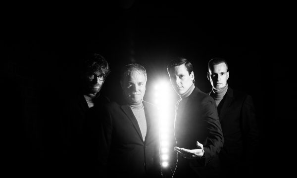 THE JENGLERS wearing suits in dark tunnel in old factory on forth promotion picture done by John Alexander Bell in October 2019